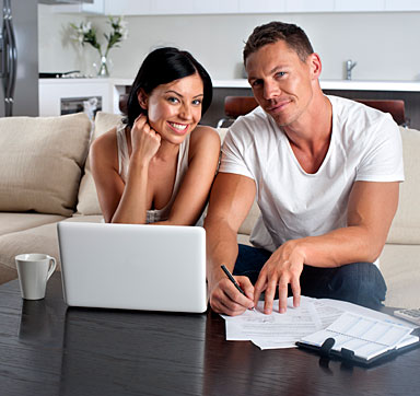 A couple making numbers to pay the mortgage